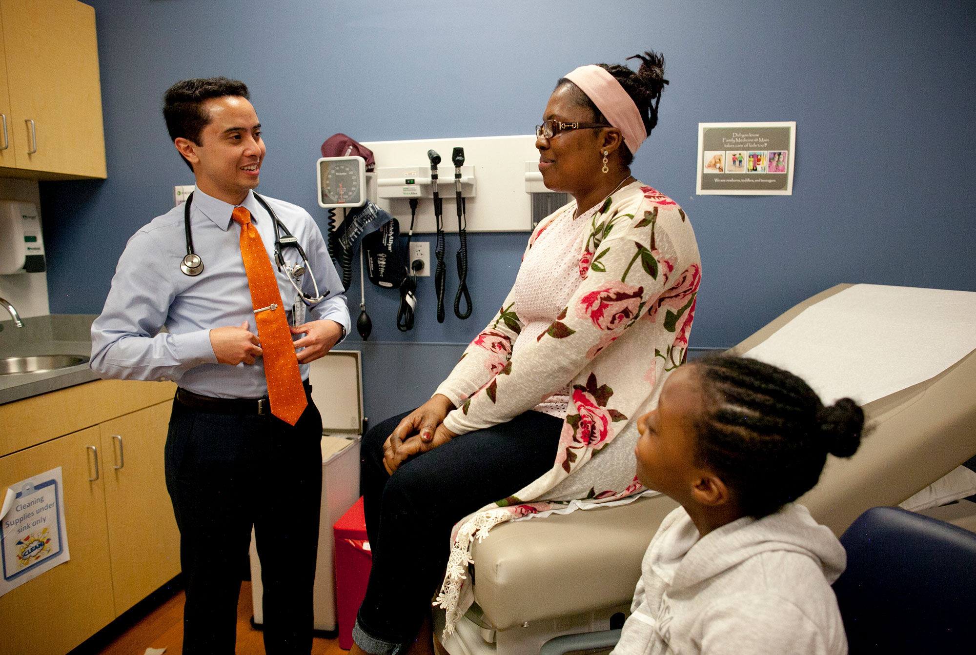 Forging a bond: Gislaine Maurice discusses her symptoms with Dr. Sean Taasan as daughter Deborah looks on (Main Street Clinic).