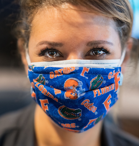 Gator nurses, doctors and technicians worked tirelessly through the first wave of the pandemic to care for patients with COVID-19. Here an unidentified UF Health Shands nurse shows her Gator pride with a handcrafted face mask.