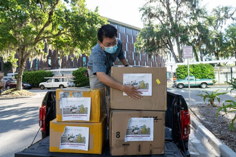 The Chinese Gainesville Community raised more than $30,000 in three days to provide UF Health with protective gear. Here, organizer Changweng Deng delivers boxes of supplies to UF Health Shands in March.