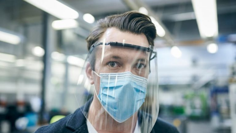 A Ford worker wears one of the 14 million face shields the automotive company made and donated to hospitals in 50 states, including UF Health Shands.