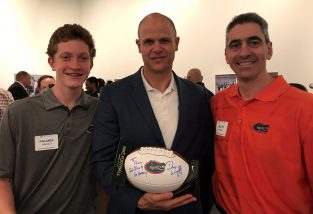 Scott Pressly (pictured with son Palmer) and former Heisman winner Danny Wuerffel (BSPR '96) have teamed up to improve communities in Atlanta and in other cities. (Photo courtesy Scott Pressly)