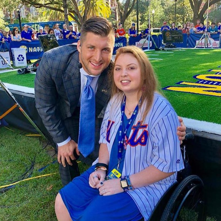 """Mariel was supported by many friends in the Gator Nation as she worked to return to UF – among them, Heisman Trophy winner Tim Tebow (BSA '09). Nine months into her recovery, the Tim Tebow Foundation hosted Mariel's family in Gainesville for the LSU vs. Florida game (October 6, 2018). Mariel appeared alongside Tebow as his guest on ESPN's """"SEC Nation."""""""