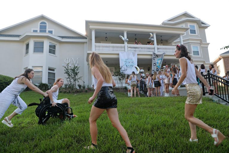 Phi Mu sorority welcomed back Mariel with open arms in fall 2019. The chapter's historic building underwent an extensive renovation, installing an elevator and a wheelchair-accessible shower to ensure that Mariel and other disabled sisters have equal access. Above, Mariel gets a push in front of Phi Mu house on Bid Day, August 22, 2019.