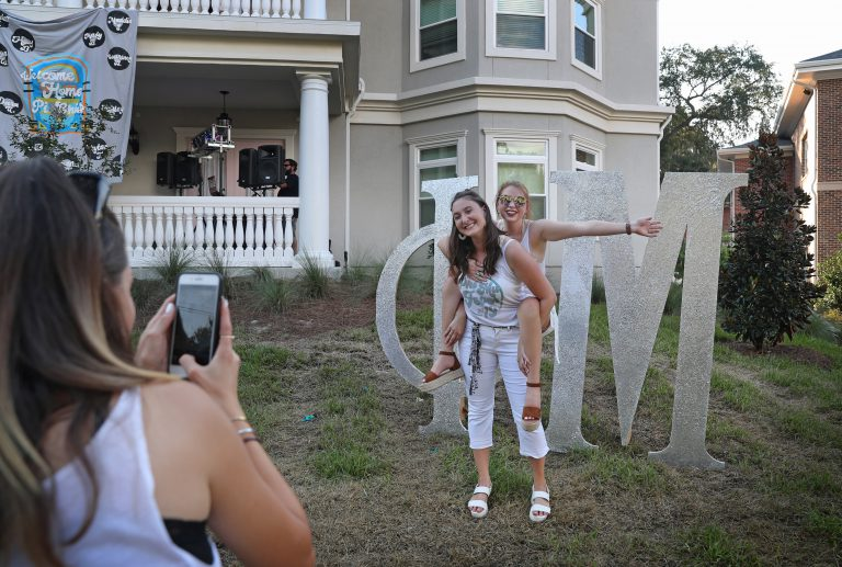 """Mariel's friends worked to bridge the accessibility gap to include her in group activities – carrying her up flights of stairs or even on their backs, if necessary. Above: Close friend Riley Marshall gives Mariel a piggyback ride in front of Phi Mu house on August 22, 2019. <br><br>  """"I'm glad my friends are learning about accessibility and how it really impacts me,"""" Mariel said. """"It's something I never even noticed or considered before, but now I have to think about it everywhere I go."""""""