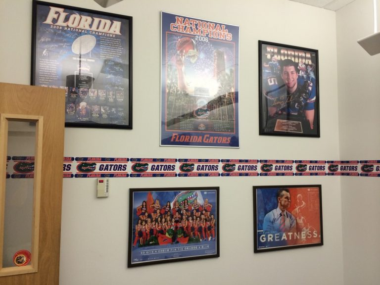 Gator pride isn't hard to find, even in the TI headquarters in Dallas. Check out Rob Taylor's office, complete with UF border and athletics posters.