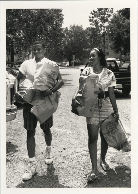 As students began to rely more on mini fridges and en suite kitchens, move-in day grew to encompass a new ritual: shopping for groceries. Here, two UF undergrads head back to their dorms after a shopping spree at Winn-Dixie supermarket, in August 1990.