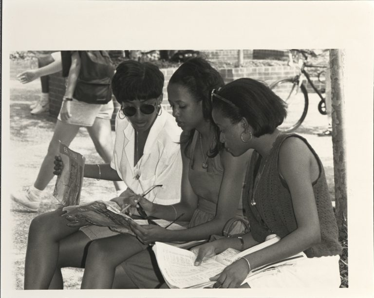 Printed campus maps are still offered to new students at UF. In Fall 1993, when this photo was taken, they were the only option.