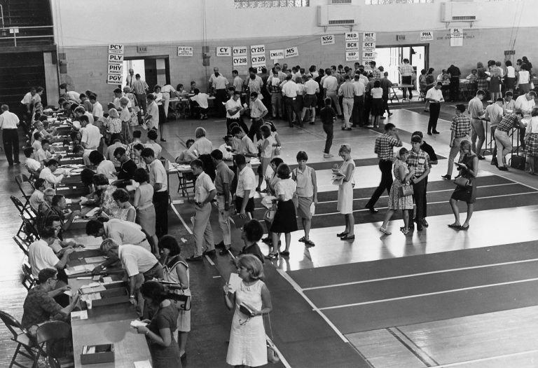 In the days before online registering, students, like these in the 1960s, had to stand in line at the Florida Gym.