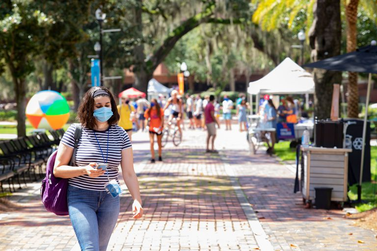Face masks are required outdoors at UF when there's a chance social distance can't be maintained. Paulina Kalantarov, a senior, isn't taking any chances.