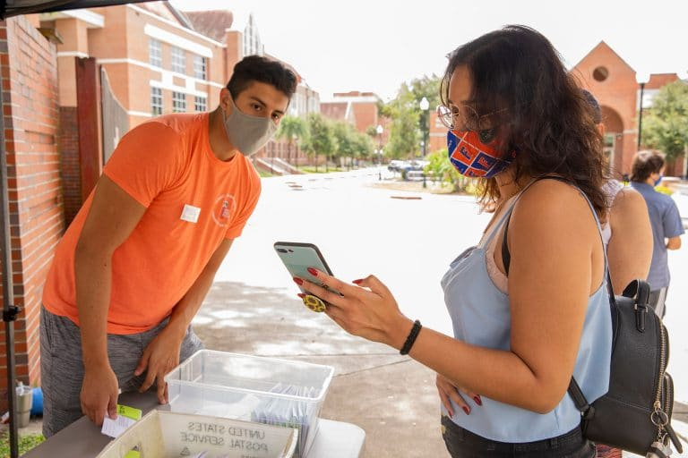 UF sophomore Alyssa Ramesh, right, gets help from student Enrique Trevino during dorm check-in at Sledd Hall on Saturday, August 22.