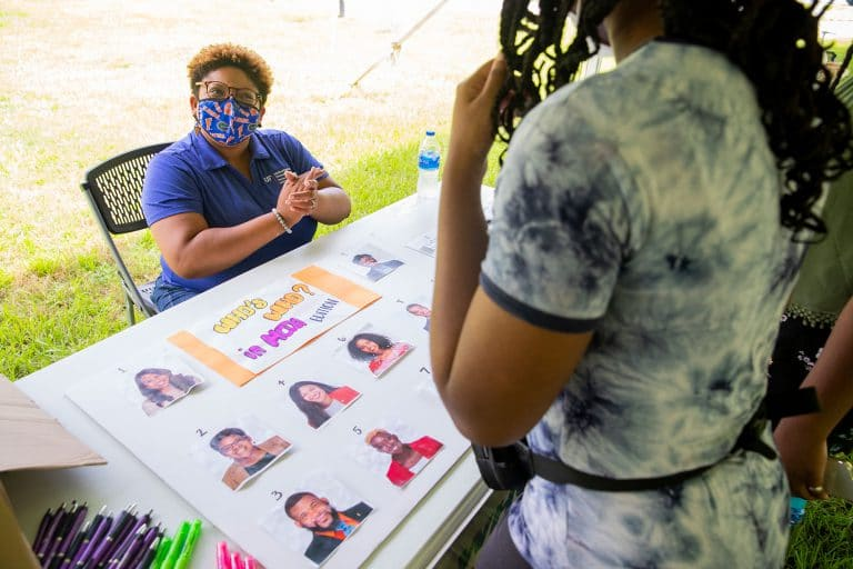"""Patricia Jordan, Multicultural and Diversity Affairs interim senior director, greets an incoming freshman at the """"Who's Who at MCDA"""" during the Sweet Event."""