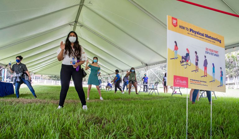 Student Affairs planned icebreaker and welcome back events to help students get comfortable and have fun. Incoming freshman Yusra Ahmed practices social distancing while playing Simon Says during the Sweet Event on the north lawn of the Reitz Union.