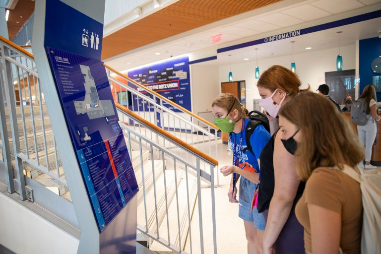From left, incoming freshmen Jacqueline St. Pierre, Cori Cowley and Ashley Blun use the map in the Reitz Union to find their classroom on the first day of classes.