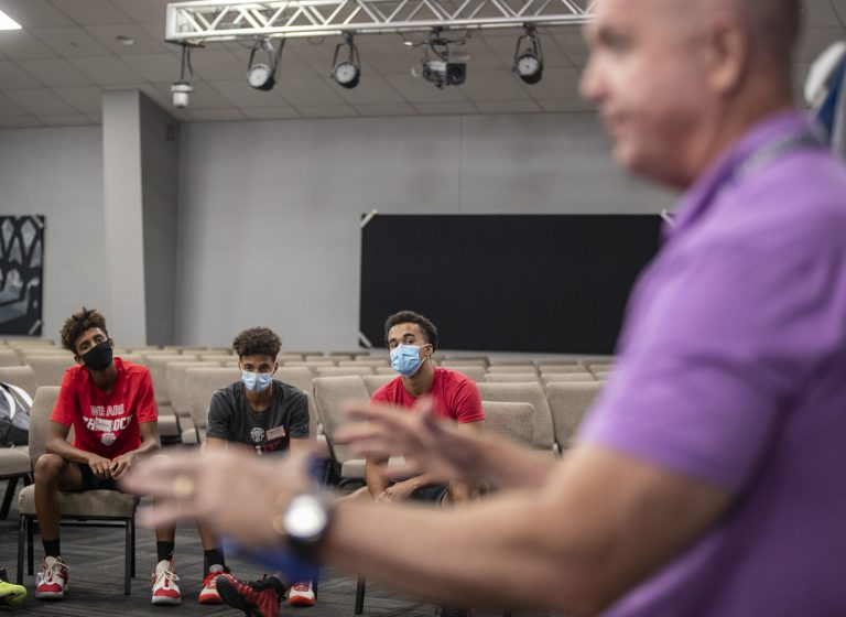 """Dialogues like these between police and youth are """"part of the solution"""" to improving police department/community relations, says Will Halvosa, shown in the foreground talking to youth from The Rock School. """"They create the trust and build up the fellowship with our community and our kids,"""" he says."""