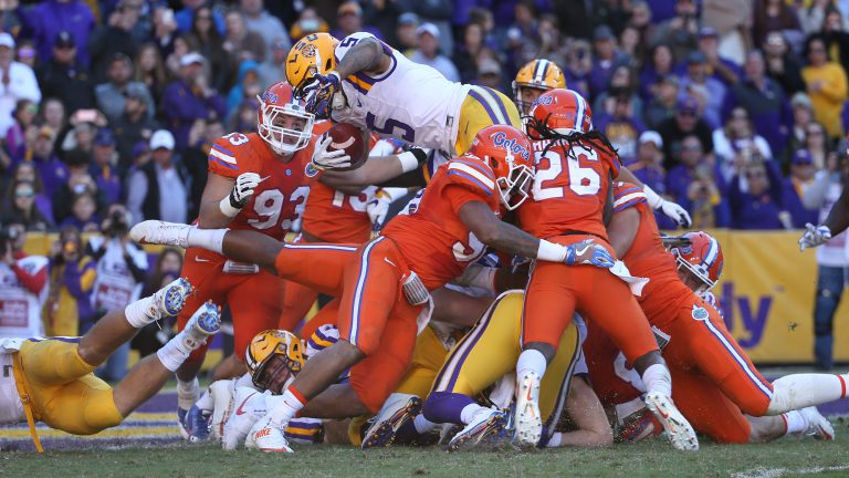 Gators proved victorious at the end of this brawl of a UF-LSU game by preventing this last-second attempt to score. Among the victors pictured here are No. 93 Taven Bryan (2014-17) and No. 26 Marcell Harris (BA '17).