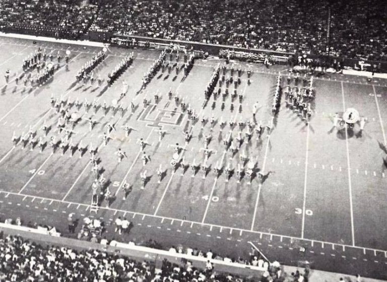 "During the 1960s and early '70s, Rolf played clarinet and Anne, trumpet, in The Pride of the Sunshine. This photo from 1971 shows the band forming a star shape as they perform the song ""Jesus Christ Superstar"" at halftime."