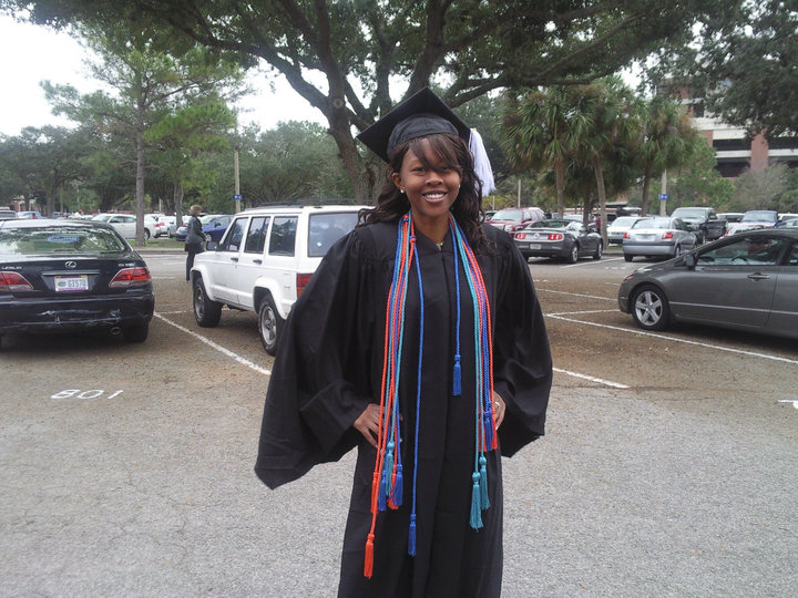 Earning her bachelor's degree in sociology from UF in 2009 fulfilled a childhood dream that had been instilled by her father. This photo taken in the O'Connell Center parking lot shows a proud Witter in cap and gown, sporting colored honors cords that designate graduating with honors and serving in academic clubs.