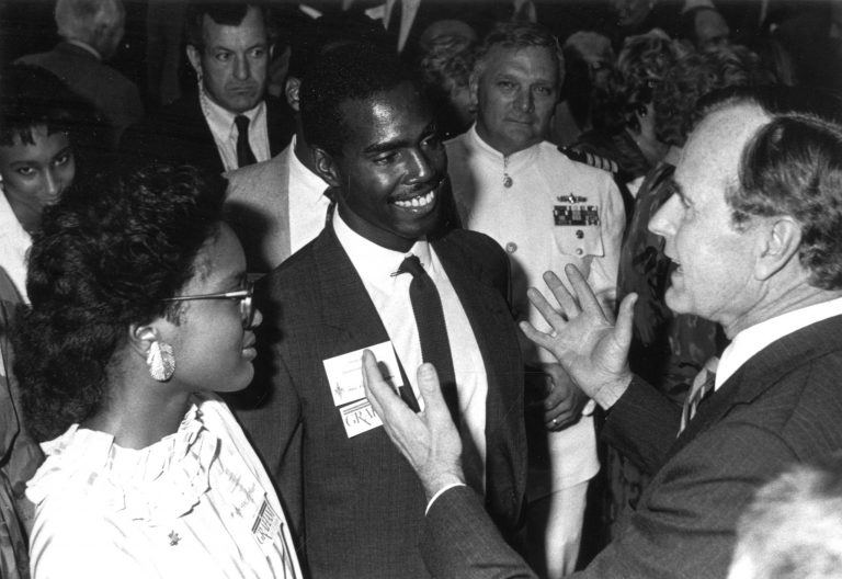 For decades, the Homecoming Banquet was a must-attend for Florida politicians, as well as national leaders. The 1986 banquet was no exception. In this photo, then-Vice President George H. W. Bush mingles with members of the crowd, two of whom wear stickers declaring their support for Gator Bob Graham, who was running for his first term as U.S. senator. Bush's son, Jeb, would be appointed Florida's secretary of commerce the following year, and Bush would be sworn in as America's 41st president in January 1989.