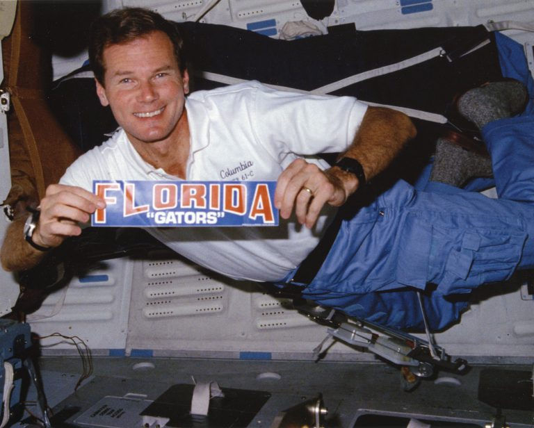 As a payload specialist on the Columbia space shuttle in 1986, then-U.S. Congressman Bill Nelson proudly displayed his Gator spirit, becoming the first member of the House to travel into space. While attending UF in the 1960s, Nelson was a member of Florida Blue Key and Beta Theta Pi fraternity. Nelson's political career encompassed two terms as a U.S. senator, from 2001 to 2019, filling a seat that had been vacated by a fellow Gator, Connie Mack III.