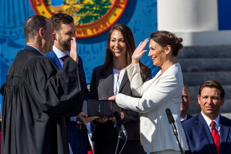 Nikki Fried (BA '98, MA '03, JD '03) made history two years ago when she became the first woman elected as Florida's commissioner of agriculture and consumer services. For her swearing-in ceremony on Jan. 8, 2019, Fried asked to borrow a copy of the first Hebrew Bible published in the United States from UF's Price Library of Judaica. Photo by Colin Hackley.