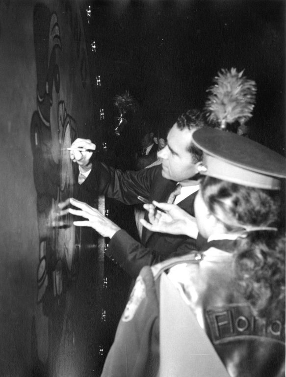 Vice President Richard Nixon maintained a hectic campaign schedule in 1960; his outreach to UF students may have helped him carry the state of Florida that November, despite losing the overall race. Here, Nixon signs the UF Marching Band's big drum.