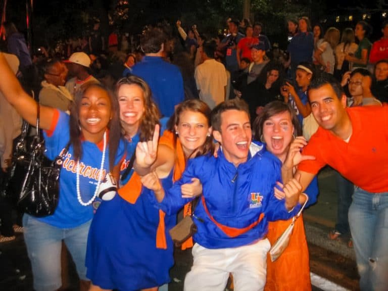 Kaiser-Cross (center) with friends in 2007 as Gator Nation celebrates UF football's national championship win.
