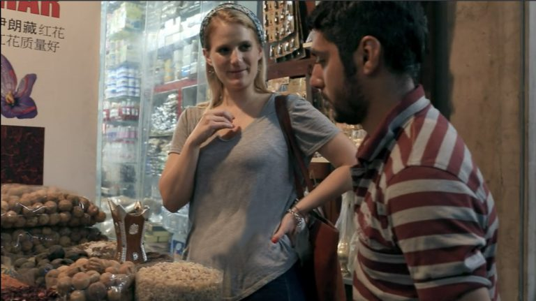 Since graduation, Kaiser-Cross has lived on four continents. She is pictured above in a Dubai market, where she stopped to sample dried lemons and other fruit.