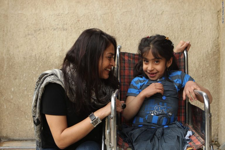 """Basu has been following the story of Noor al-Zahra, a girl from Baghdad born in 2005 with spina bifida. American soldiers shuttled the girl to Atlanta for lifesaving surgery, but her life has been difficult since she was returned to Iraq at about 9 months old. Basu did a follow-up story in 2013 and traveled to Uganda in 2017 when the girl had more surgery to relieve fluid buildup in her brain. """"I carry a school photo of Noor in my wallet as though she were the daughter I never had,"""" says Basu. Photo by David Holloway"""