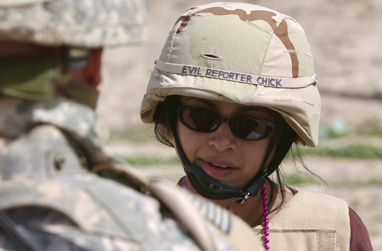 """While embedded with troops during the Iraq War, Basu earned the affectionate nickname """"Evil Reporter Chick."""" Photo by Curtis Compton"""