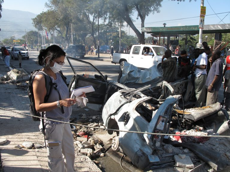 """CNN sent Basu to Port-au-Prince, Haiti, in January 2010 to cover the catastrophic earthquake. """"This car had been set on fire after the decomposing bodies of two people were found inside,"""" she says."""