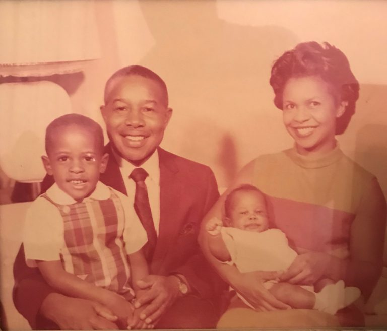 Paul C. Perkins Jr. (on his mother's lap) says even as a child, members of his Orlando community knew him, in part, because he looks so much like his late father, Paul Perkins Sr.