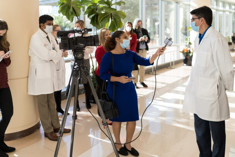 As director of Screen, Test & Protect, Lauzardo serves as the public face of UF's efforts to control COVID-19 on campus and the community. Here he speaks with a member of the press shortly after receiving his first dose of the Moderna COVID-19 vaccine in December 2020.
