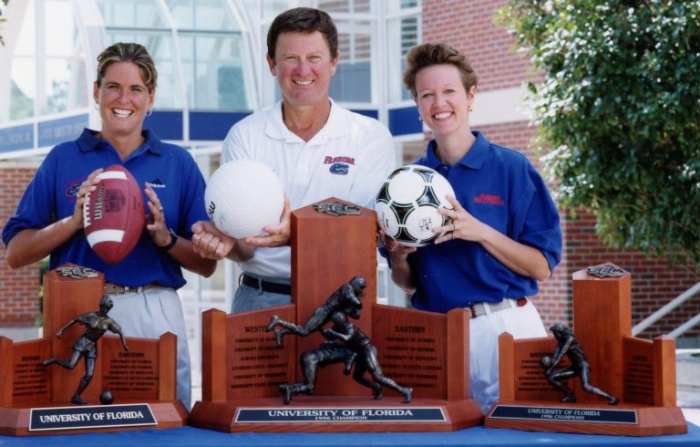 During Burleigh's 26-year career at UF, she won 14 SEC regular-season titles, 12 SEC tournament wins, 22 NCAA Tournament appearances, one national title and a total of more than 500 victories. She is pictured here after winning the 1996 SEC Championship, alongside other SEC Champion coaches Steve Spurrier and Mary Wise.