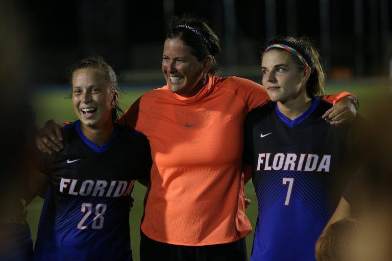 Retiring UF head soccer coach Becky Burleigh, center, with 2015-16 midfielder Meggie Dougherty Howard (BSBA '16) and 2013-16 forward Savannah Jordan (BA '16, MS '20).
