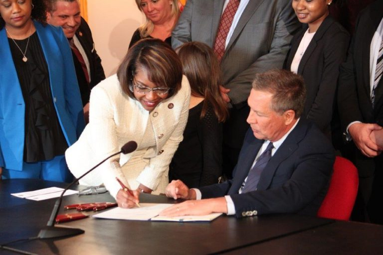 Not long after winning her seat in the Ohio House of Representatives, Emilia Sykes and former Ohio Gov. John Kasich signed a dating violence bill, a law sponsored by Sykes to protect victims.