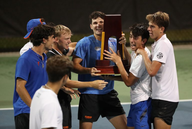 Surrounded by his teammates, Sam Riffice hoists the team's NCAA national championship trophy. Riffice is now preparing to compete in the tennis U.S. Open, scheduled for Aug. 30-Sept. 12 in New York City.
